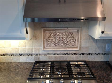 Ceramic Tile Murals For Kitchen Backsplash hand pressed floral tiles installed in kitchen backsplash