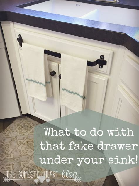 kitchen towel rack sink what to do with that drawer your kitchen sink
