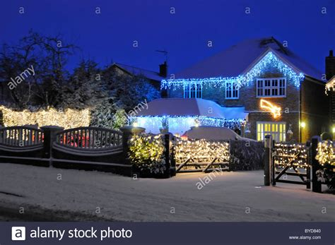 houses with lights snow house with lights stock photo royalty free