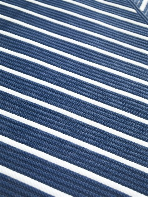 blue and white striped indoor outdoor rug has crisp