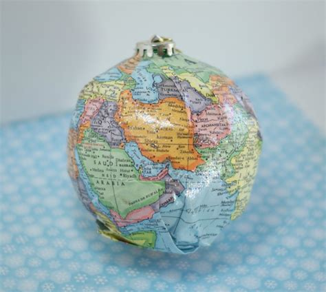diy map ornaments w sparkle mod podge