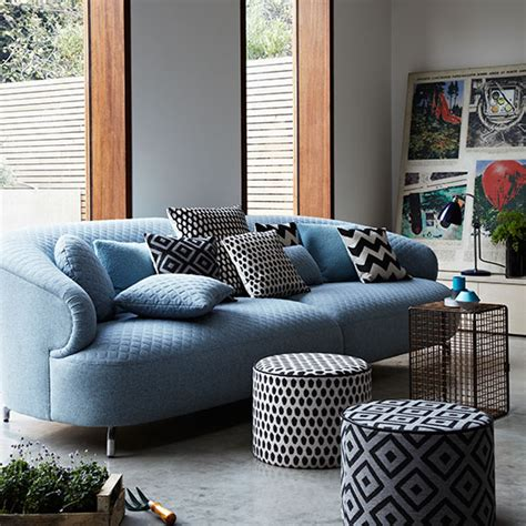 blue couches living rooms modern living room with blue sofa and poufs decorating