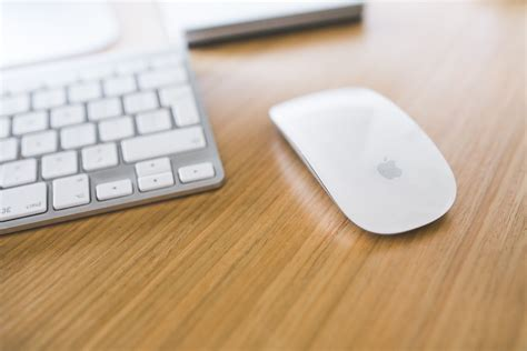 on office desk white apple mouse and keyboard on a wooden desk 183 free