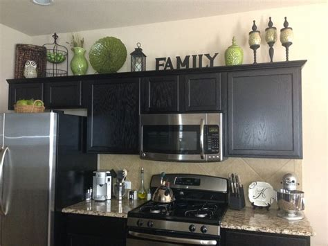 decorating above kitchen cabinets ideas home decor decorating above the kitchen cabinets kitchen decor green black brown color
