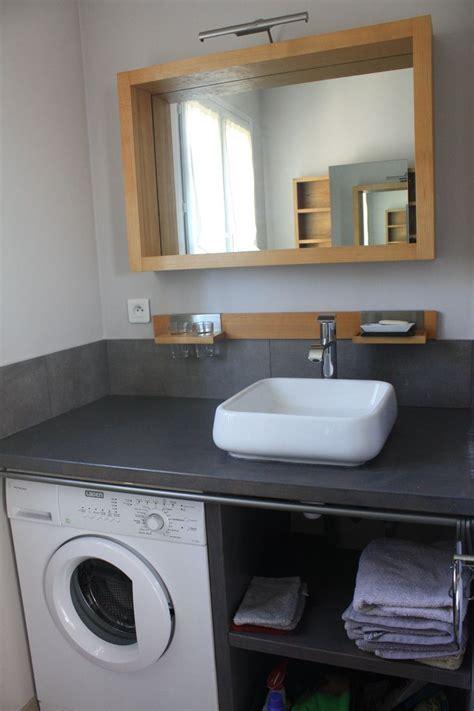 salle de bain comprenant vasque wc lave linge rangement linge de toilette home