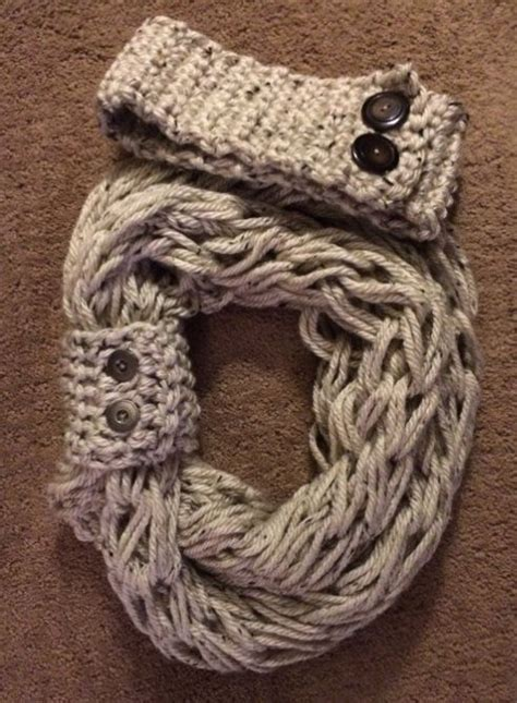 how to knit a scarf arm knit infinity scarf with matching button cuff and