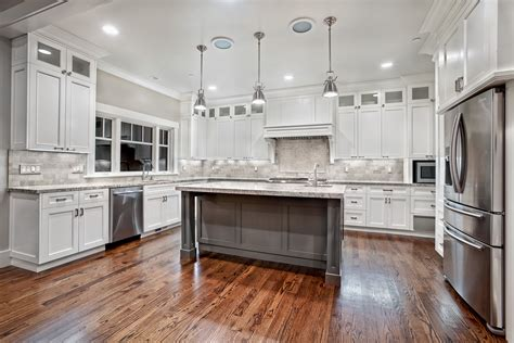 white kitchen with island awesome varnished wood flooring in white kitchen themed