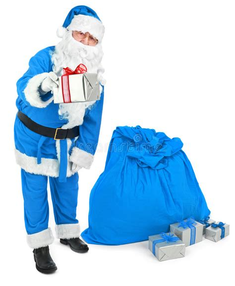 blue santa blue santa gives a present stock photo image 62551253