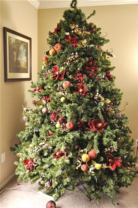 how to place garland on tree she tucks a flower into tree when the