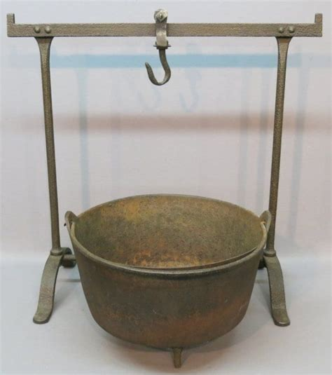 early wrought iron fireplace hanger and a pot antique