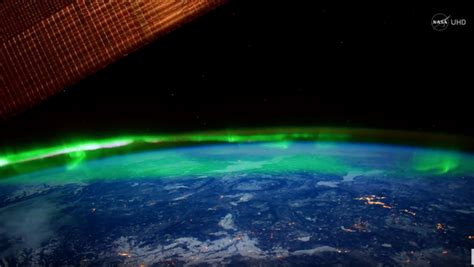 view lights breathtaking view of the northern lights from space in