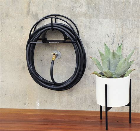 garden hose holders wall mount 10 easy pieces hose hangers from high to low gardenista