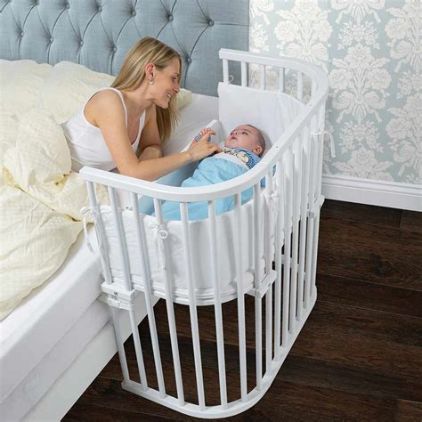crib that hooks to bed bedside co sleeper that attaches to parents bed babybay
