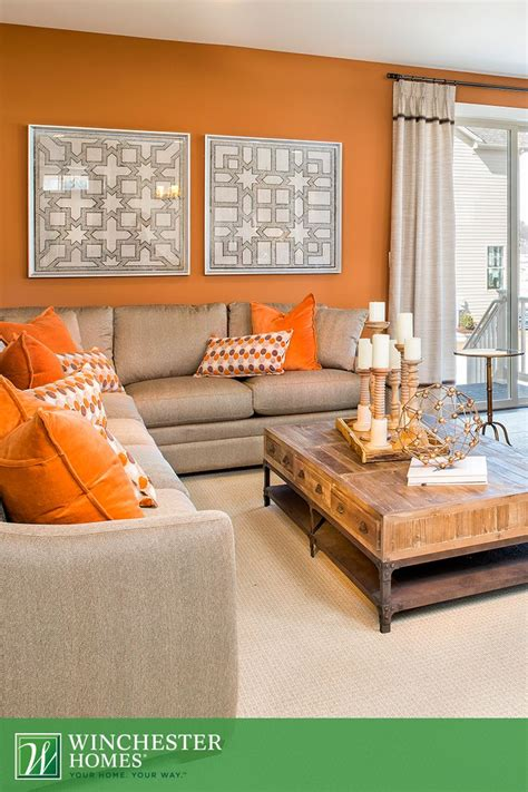 orange walls orange walls patterned artwork and light carpets add to