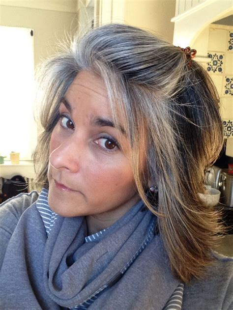 high lighted hair with gray roots nine months of grow out salt pepper roots blending with