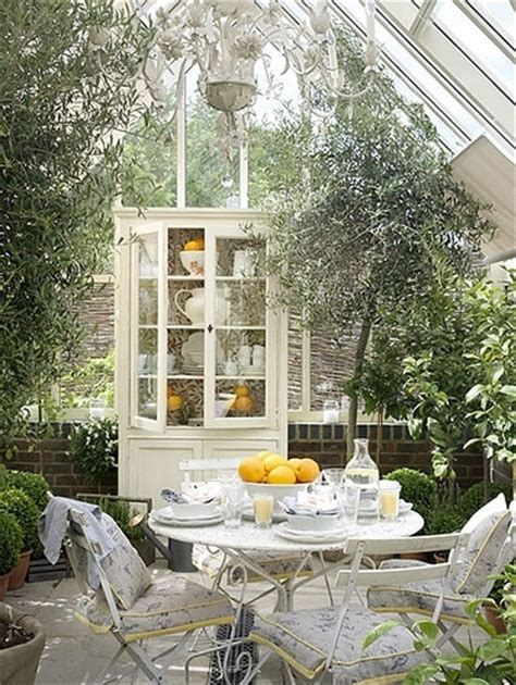 greenhouse chandelier bright cabinet chairs chandelier conservatory dining