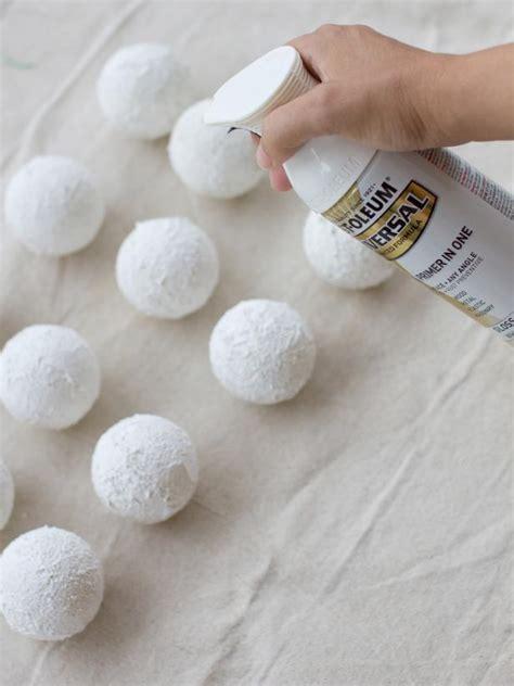 spray painting styrofoam craft glittering snowball ornaments hgtv