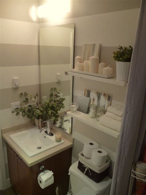 bathroom decor ideas for apartment a basket is a great way to store toilet paper in a small apartment bathroom small