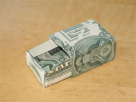 origami for dollar bills an origami koi fish made with a 1 dollar bill rebrn