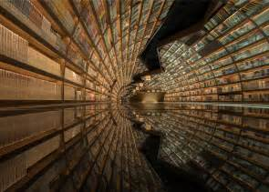 the tunnel picture book tunnel of books shelves wrap curved bookstore walls