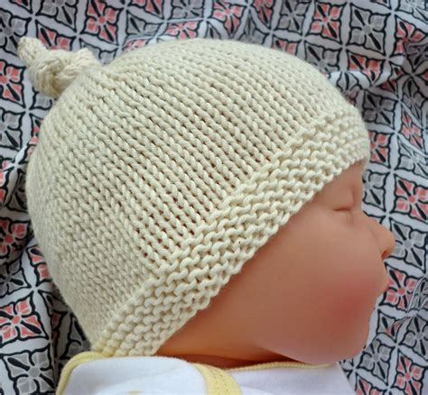 free knit baby hat patterns lovefibres tegan baby hat with top knot pattern