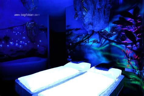 black light and glow in the paint artist paints rooms with murals that glow blacklight