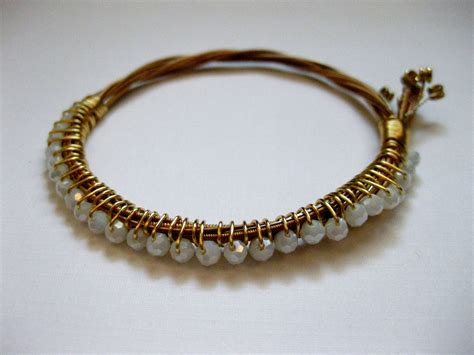 how to make guitar string jewelry gold and white beaded guitar string bracelet gold