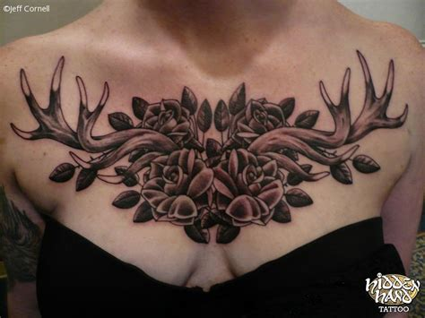 antlers and roses chest piece hidden hand tattoo seattle wa