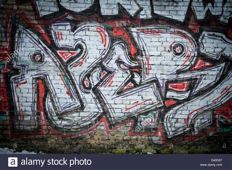 spray painting on walls a graffiti spray painted brick wall using black and