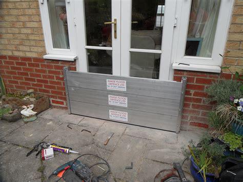 Garage Door Flood Barrier A Flood Barrier Installation To A Set Of Doors