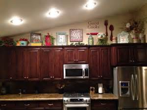 Top Of Kitchen Cabinet Decorating Ideas how to decorate on top of cabinets with vaulted ceiling
