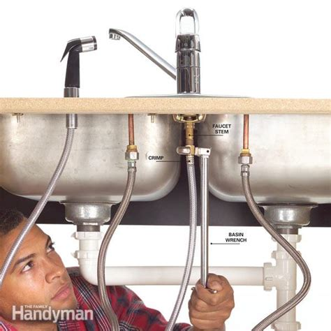 how to change a kitchen faucet with sprayer how to fix a leaking sink sprayer the family handyman