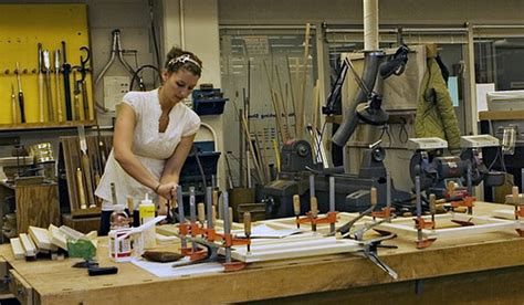 woodworking photos a student works on an architecture project in the