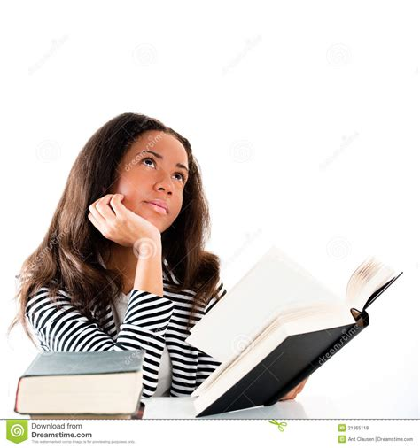 thinking in pictures book smiling student with open book thinking stock photo