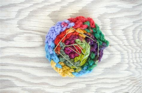 how to make finger knit flowers finger knitted yarn flowers a diy tutorial for