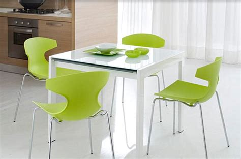 bright green kitchen chairs around a white table