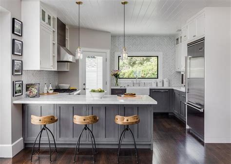 gray and white kitchen cabinets gray distressed kitchen cabinets with marble herringbone