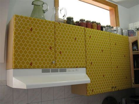 kitchen cabinet cover how to cover the kitchen cabinets in fabric