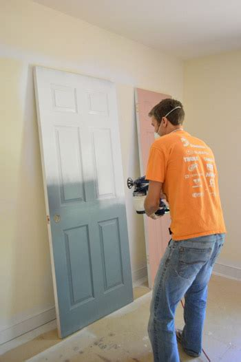 spray painting house priming and painting our trim and doors with a paint