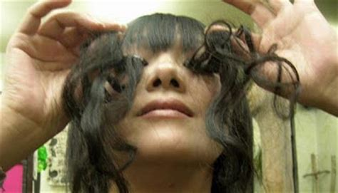 pubic hair world record world s longest eyelashes damn cool pictures