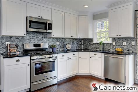 pictures of kitchens with white cabinets and black appliances white kitchen cabinets cabinets
