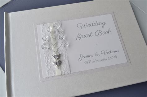 wedding guest book pictures birds orginal design ivory personalised wedding