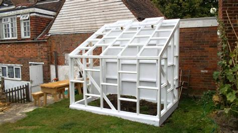 building a glass walled wooden lean to greenhouse