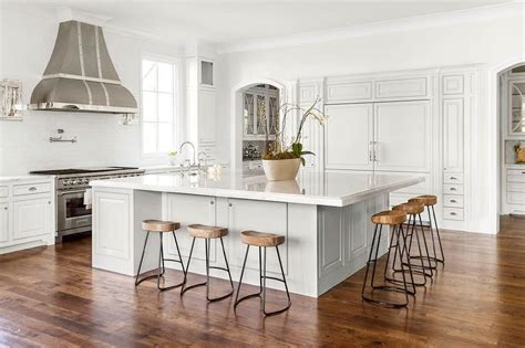 oversized kitchen island with smart and sleek stools transitional kitchen
