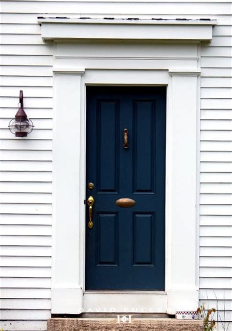 navy blue front doors maybe light mossy green house with blue door and