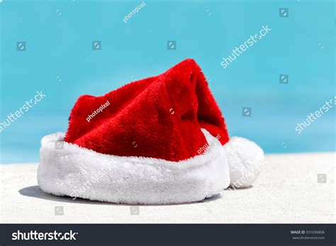 turquoise santa hat santa claus hat near swimming pool with clean turquoise