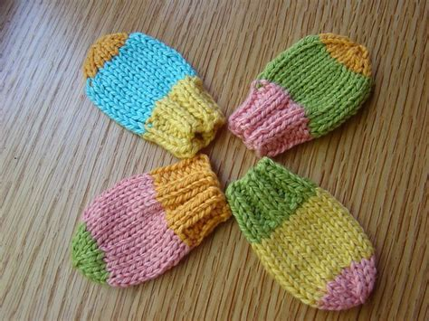 easy knit baby mittens thumbless baby mitts you could add a simple crochet chain