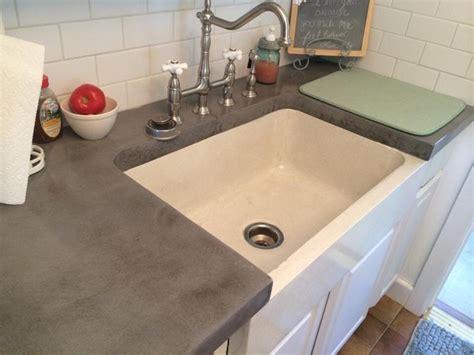 Kitchen Island Lights Fixtures concrete farmhouse sink and cool grey concrete countertops
