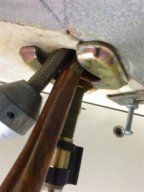 how to remove a kitchen sink faucet can someone help me figure out how to remove this faucet doityourself community forums