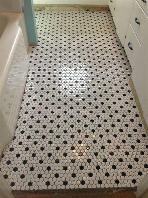black and white bathroom tile designs best 25 white tile bathrooms ideas on black